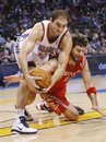 Oklahoma City Thunder center Nenad Krstic , left, of Serbia, grabs the ball next to Houston Rockets center Brad Miller during the third quarter of an NBA basketball game in Oklahoma City, Wednesday, Nov. 17, 2010. Oklahoma City won 116-99.