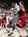 Michigan State 's Derrick Nix (25) drives against Indiana's Tom Pritchard during the second half of an NCAA college basketball game, Sunday, Jan. 30, 2011, in East Lansing, Mich. Michigan State won 84-83 in overtime.