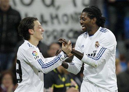 Real Madrid's Emmanuel Adebayor From Togo, Right, Celebrates
