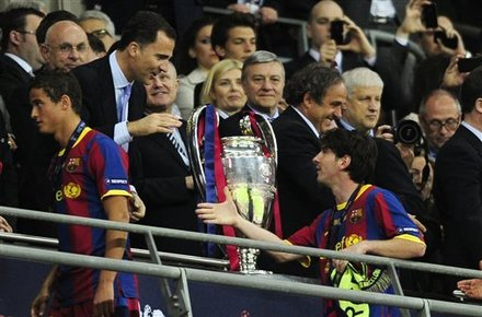 Barcelona''s Lionel Messi, Right, Goes