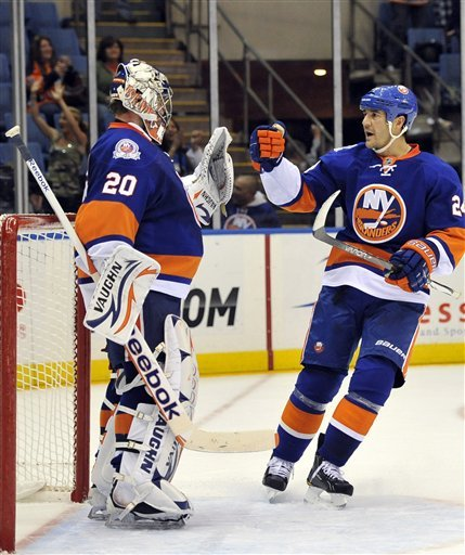 New York Islanders' Steve Staios (24) Congratulates