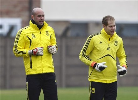 Liverpool goalkeeper Pepe Reina, right, and teammate Peter Gulacsi, during a training session at Liverpool's training ground, Liverpool, England, Wednesday March 16, 2011. Liverpool will play Braga in the second leg of their Europa League soccer match on Thursday.