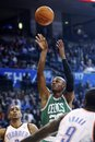 Boston Celtics guard Ray Allen , center, shoots between Oklahoma City Thunder guard Thabo Sefolosha , left, and forward Serge Ibaka , right, during the first quarter of an NBA basketball game in Oklahoma City, Sunday, Nov. 7, 2010. Boston won 92-83.
