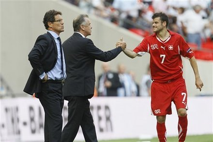 Switzerland''s Tranquillo Barnetta, Right, Reacts