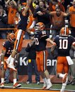 Syracuse's Nick Provo (80) celebrates with teammates after catching a touchdown pass against West Virginia during the third quarter of an NCAA college football game in Syracuse, N.Y., Friday, Oct. 21, 2011. Syracuse won 49-23.