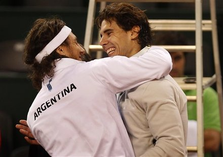Spain's Rafael Nadal, Right, And Argentina's Juan Monaco React