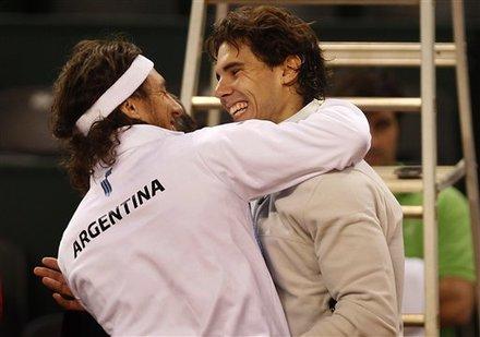 Spain's Rafael Nadal, Right, And Argentina's Juan Monaco React