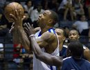 Denver Nuggets ' Kenyon Martin , left, is fouled as he shoots while playing in an Impact League basketball game, Tuesday, Sept. 20, 2011, in Las Vegas. About 50 NBA players have gathered in Las Vegas to train privately and play pick-up games during the lockout.