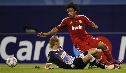 Real Madrid's Marcelo, Right, Is