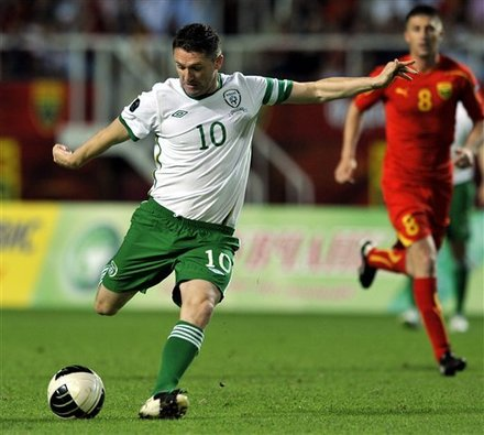 Republic Of Ireland's Robbie Keane, Left, Scores