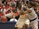 Tennessee guard/forward Shekinna Stricklen (40) is guarded by Ohio State center Jantel Lavender during the second half of an NCAA women's college basketball tournament regional semifinal, Saturday, March 26, 2011 in Dayton, Ohio . Stricklen led Tennessee to an 85-75 win with 20 points.