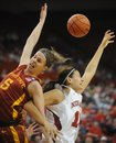 Iowa State 's Hallie Christofferson (5) and Nebraska's Jessica Periago (13) go for a rebound, during an NCAA college basketball game Wednesday, Jan. 26, 2011 in Lincoln, Neb.