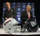University of Massachusetts Amherst Chancellor Robert Holub, left, arrives with New England Patriots owner Robert Kraft for a news conference where it was announced that the school will switch to the Mid-American Conference, Wednesday, April 20, 2011,at Gillette Stadium in Foxborough, Mass. UMass will play its home games at Gillette Stadium beginning in 2012 and play its first schedule as a full member of the MAC in 2013.