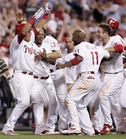 Philadelphia Phillies Carlos Ruiz, Left, Is