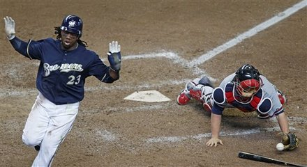 Milwaukee Brewers' Rickie Weeks (23) Scores