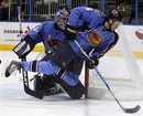 FILE - In this Feb. 3, 2011, file photo, Atlanta Thrashers defenseman Ron Hainsey (6) dives for the puck as Thrashers goalie Ondrej Pavelec looks on in the first period of an NHL hockey game against the Calgary Flames in Atlanta. NHL Commissioner Gary Bettman, Deputy Commissioner Bill Daly and True North Sports and Entertainment denied a deal has been reached to sell the team to True North, which would relocate it to Winnipeg, Manitoba. The Globe and Mail in Toronto reported Thursday, May 19, 2011, that the Thrashers' agreement with True North was done and will be announced in Winnipeg on Tuesday.