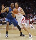 Houston Rockets ' Kevin Martin (12) drives against Minnesota Timberwolves ' Wesley Johnson (4) during the first quarter of an NBA basketball game Sunday, Nov. 7, 2010, in Houston. The Rockets beat the Timberwolves 120-94.