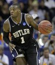 FILE - In this March 26, 2011 file photo, Butler's Shelvin Mack (1) dribbles the ball during the second half of the NCAA Southeast regional college basketball championship game against Florida , in New Orleans. The 6-foot-3 shooting guard on Tuesday, April 12,2011, said he is declaring to enter the draft but has not hired an agent, making him eligible to return to school next season.