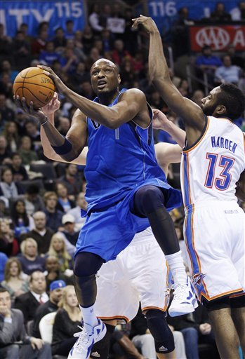 Dallas Mavericks Forward Lamar Odom, Left, Goes