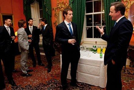 British Prime Minister David Cameron, Right, Talks