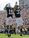 Penn State running back Joe Suhey (37) celebrates his second quarter touchdown with Justin Brown (19) during an NCAA college football game against Eastern Michigan in State College, Pa., Saturday, Sept. 24, 2011.