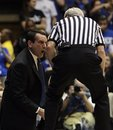 Duke coach Mike Krzyzewski, left, argues with an official after receiving a technical foul during the first half of an NCAA college basketball game Georgia Tech in Durham, N.C., Sunday, Feb. 20, 2011.