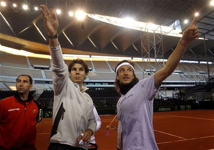 Rafael Nadal, Left, And  Juan Monaco From Argentina, Right, React As