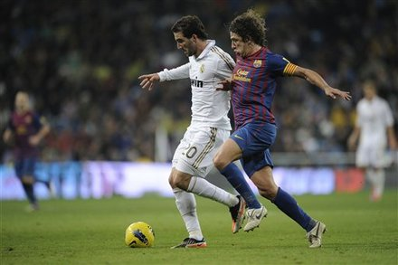 Real Madrid's Gonzalo Higuain From Argentina, Left, Duels