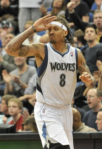 Minnesota Timberwolves' Michael Beasley Salutes