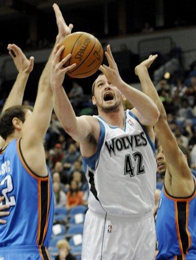 Minnesota Timberwolves' Kevin Love (42) Lays