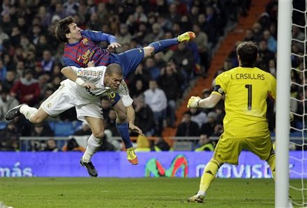 Real Madrid's Pepe From Portugal, Left,  Jumps