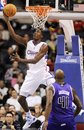 Los Angeles Clippers ' Al-Farouq Aminu scores a layup as Sacramento Kings ' Darnell Jackson looks on during the second half of a preseason NBA basketball game in Los Angeles, Tuesday, Oct. 19, 2010.