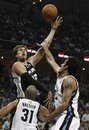 San Antonio Spurs forward Tiago Splitter (22), of Brazil, shoots over Memphis Grizzlies defenders Hamed Haddadi , right, of Iran, and Shane Battier (31) during the first half of Game 4 of a first-round NBA basketball playoff series, Monday, April 25, 2011, in Memphis, Tenn.