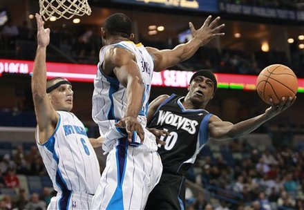 Minnesota Timberwolves Guard Jonny Flynn (10) Scores As New Orleans Hornets Forward Sasha Pavlovic (6) And Center D.J.