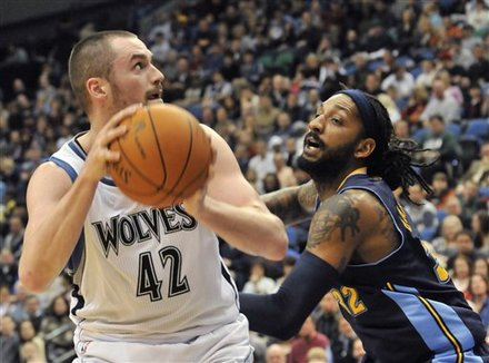 Minnesota Timberwolves' Kevin Love, Left, Looks