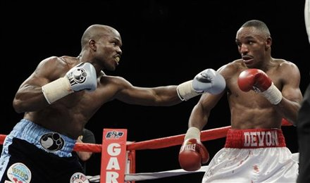 Devon Alexander, Right, And Timothy Bradley Fight
