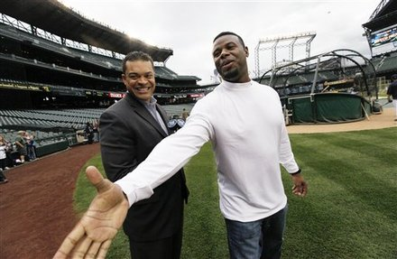 Former Seattle Mariner Ken Griffey Jr., Right, Reaches Out To Greet A Friend As He Stands With Broadcaster Michael