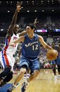 Washington Wizards ' Kirk Hinrich (12) is pressured by Detroit Pistons ' Rodney Stuckey , left, in the first half of an NBA basketball game Sunday, Nov. 21, 2010, in Auburn Hills, Mich.