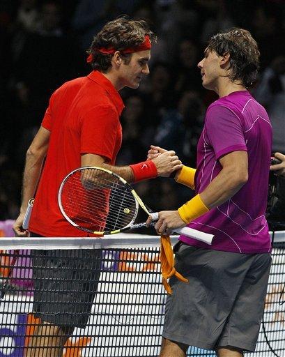 Switzerland's Roger Federer, Left, Greets