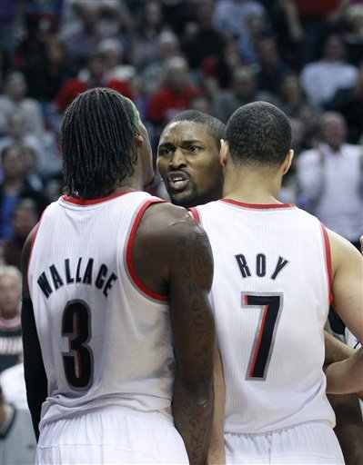 Portland Trail Blazers' Brandon Roy (7) Separates Teammate Gerald Wallace (3) And Los Angeles Lakers' Ron Artest (15)