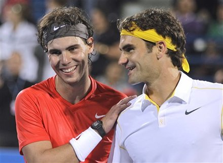 Rafael Nadal From Spain, Left, Comforts