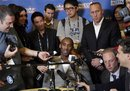Los Angeles Lakers ' Kobe Bryant , center, talks to reporters during media availability for the NBA All Star basketball game in Los Angeles, Friday, Feb. 18, 2011.