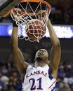 ADVANCE FOR WEEKEND EDITIONS, JUNE 18-19 - FILE - This March 18, 2011, file photo shows Kansas forward Markieff Morris dunking against Boston University in the second half of a Southwest Regional NCAA tournament second round college basketball game, in Tulsa, Okla. Morris is a top prospect in the 2011 draft.