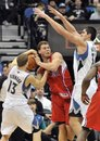 Los Angeles Clippers ' Blake Griffin , center, is double-teamed by Minnesota Timberwolves ' Luke Ridnour (23) and Darko Milicic , right, of Serbia, during the first half of an NBA basketball game Wednesday, Nov. 17, 2010, in Minneapolis.