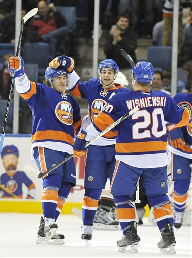 New York Islanders Center P.A. Parenteau, Center, Frans Nielsen (51), Of Denmark, And Defenseman James Wisniewski (20)