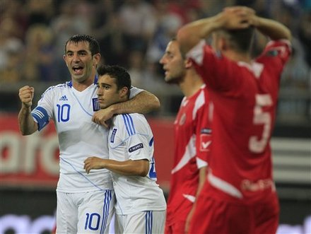 Kostas Karagounis Of Greece, Left, Reacts As He Holds The Scorer Of The Third Goal, Giannis Fetfatzidis, Against Malta