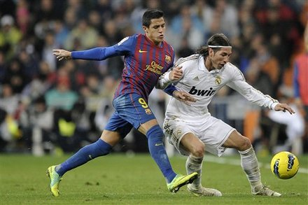 Real Madrid's Sergio Ramos, Right, Duels