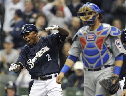 Milwaukee Brewers' Nyjer Morgan (2) Yells Out As He Scores A Run On A Double By Prince Fielder, Near <a class=