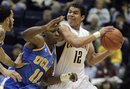 California's Brandon Smith, right, looks to pass away from UCLA's Lazeric Jones (11) during the first half of an NCAA college basketball game Sunday, Feb. 20, 2011, in Berkeley, Calif.