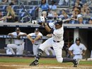 New York Yankees ' Curtis Granderson hits a single off of Baltimore Orioles starting pitcher Zach Britton in the first inning of the second baseball game of a doubleheader on Saturday, July 30, 2011 at Yankee Stadium in New York. Granderson had four hits during the Yankees 17-3 win.